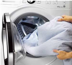 Стирка постельного белья в стиральной машине — режим и правила